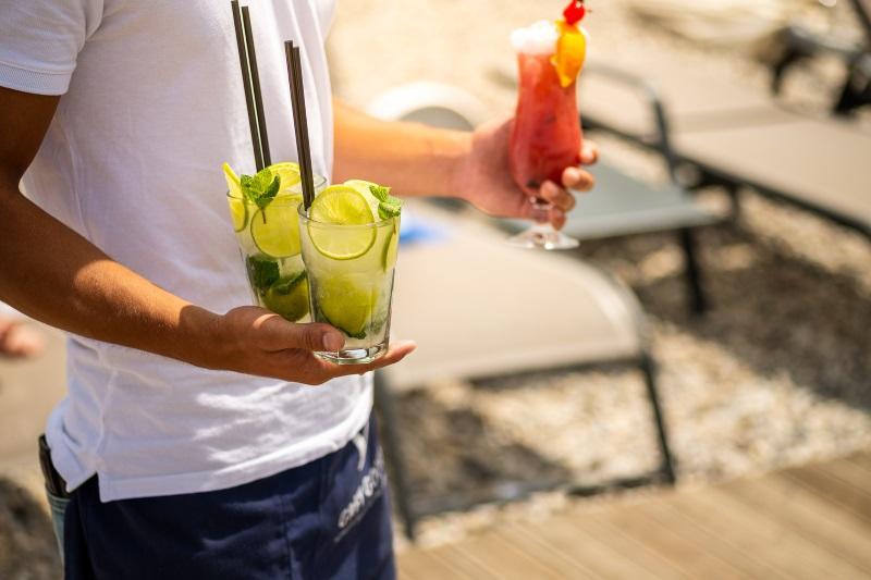 bringing cocktails sunset beach